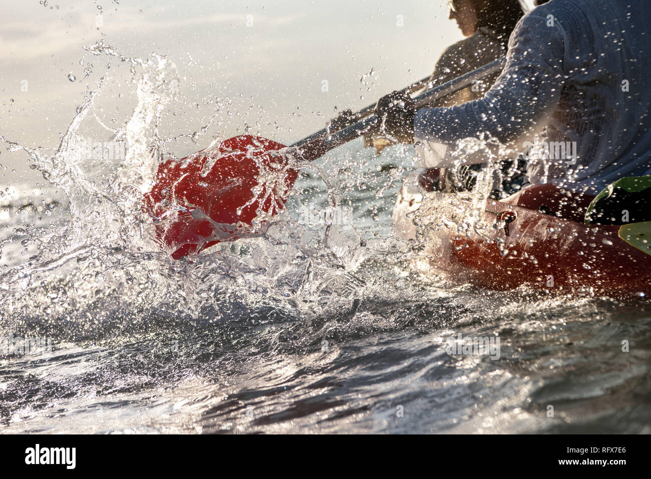Closeup photo of splashes from kayak or canoe paddle at sea bay. Kayaking or canoeing concept Stock Photo