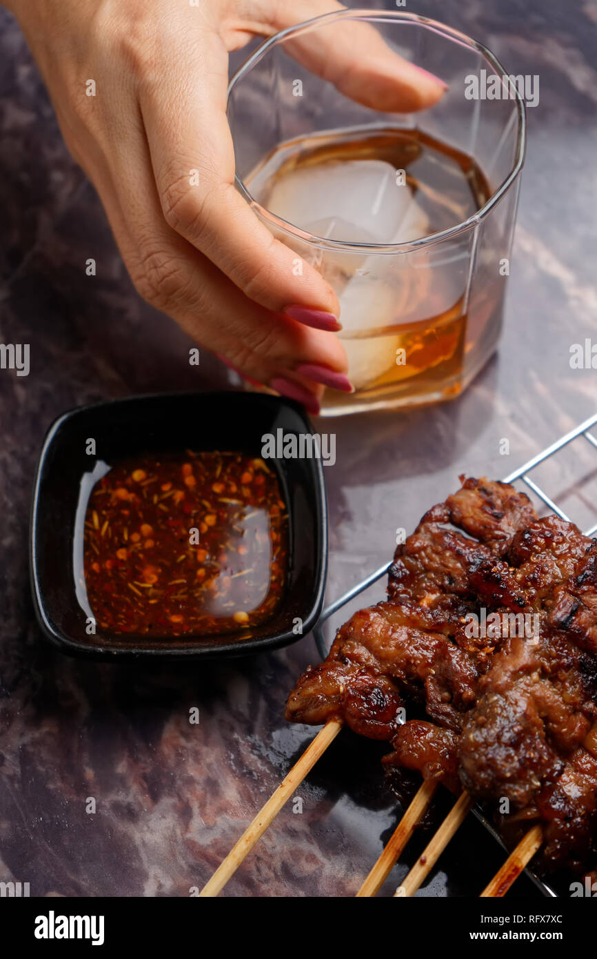 Barbecue and alcohol - Stock Image