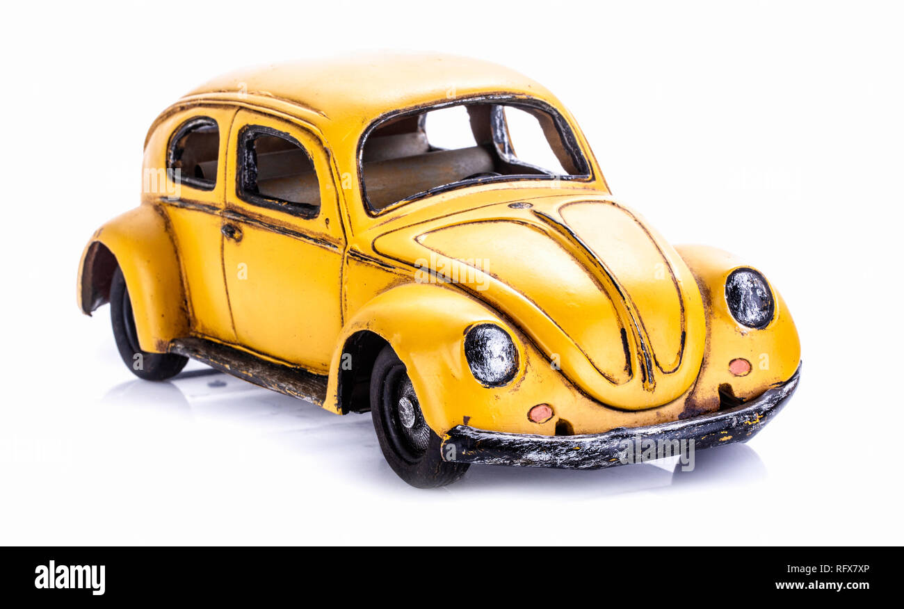 SWINDON, UK - JANUARY 27, 2014: Retro distressted VW Beettle model in Yellow on a white background. - Stock Image
