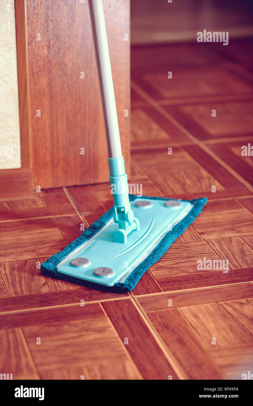 Mop for cleaning the floor is on the floor.  - Stock Image