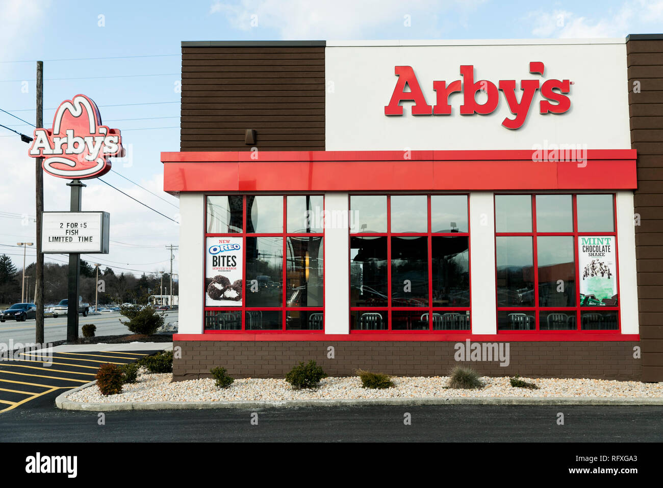 A Logo Sign Outside Of A Arby S Fast Food Restaurant