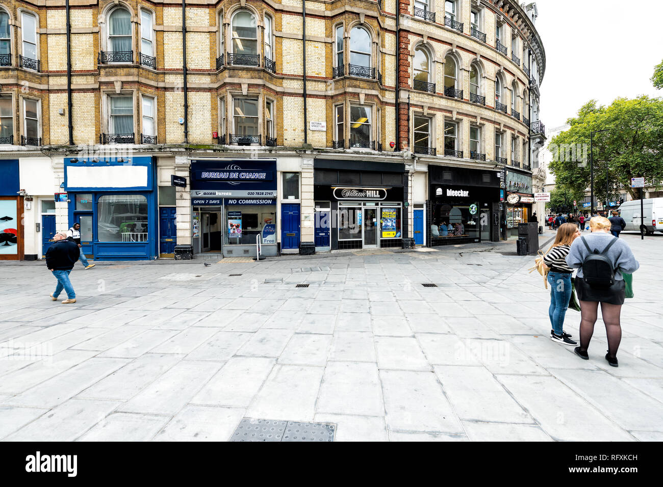 London, UK - September 12, 2018: Buckingham Palace road street during day with people walking on square by stores shops - Stock Image