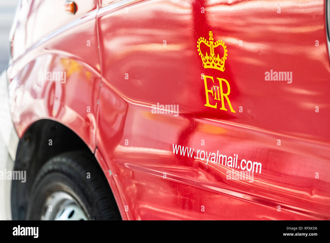 London, UK - September 13, 2018: Closeup of red Royal Mail delivery van truck car on street road in city with crown logo - Stock Image