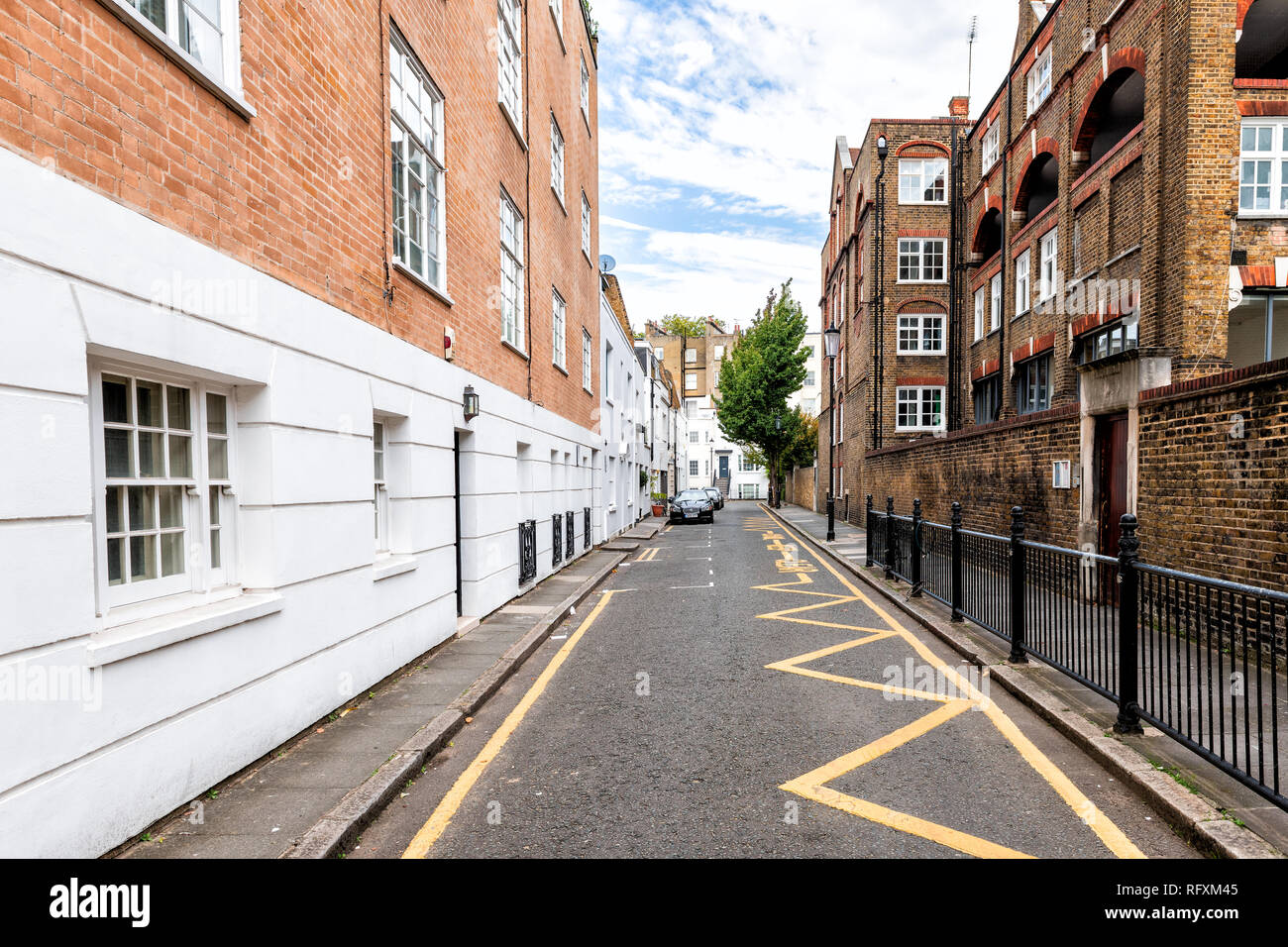 London, UK - September 16, 2018: Neighborhood district of Kensington alley street mews with empty road architecture and nobody Stock Photo