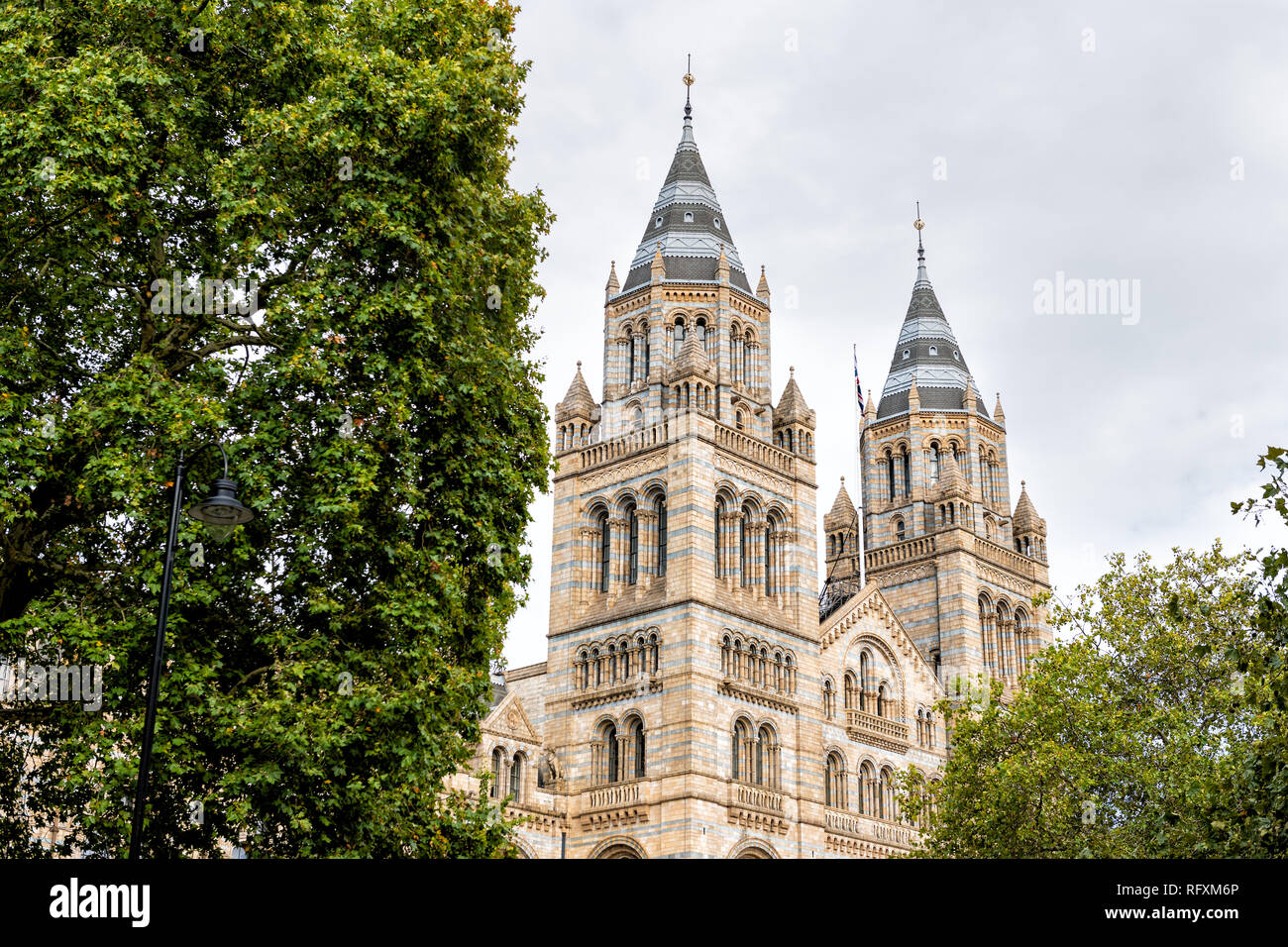 Exterior historic architecture of Natural History Museum in Kensington Chelsea area of London, UK during cloudy summer autumn day looking up and nobod - Stock Image