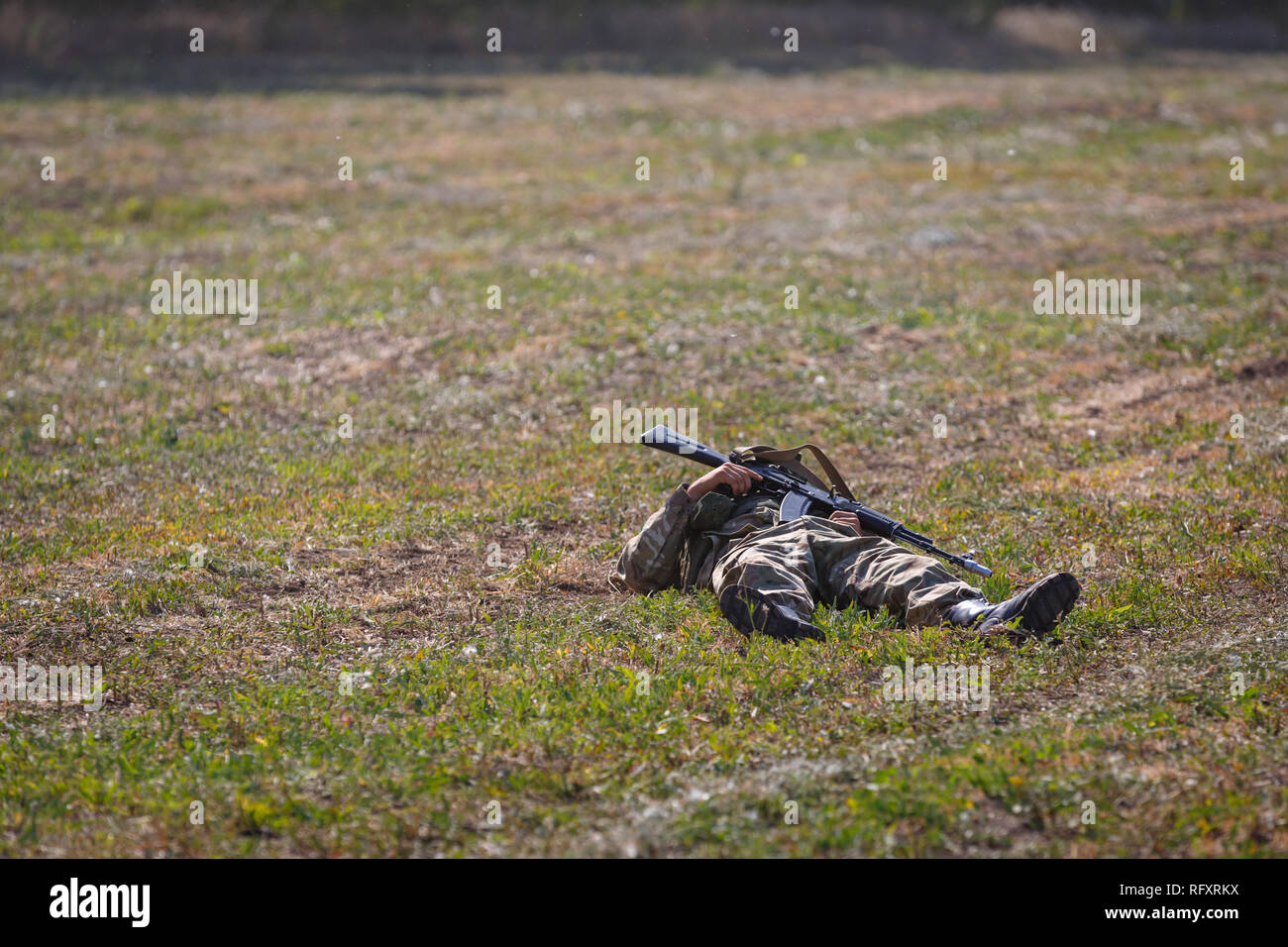 Historical festival Sambek Heights. Killed soldier of special purpose detachment with a gun in his hands lies on the battlefield - Stock Image