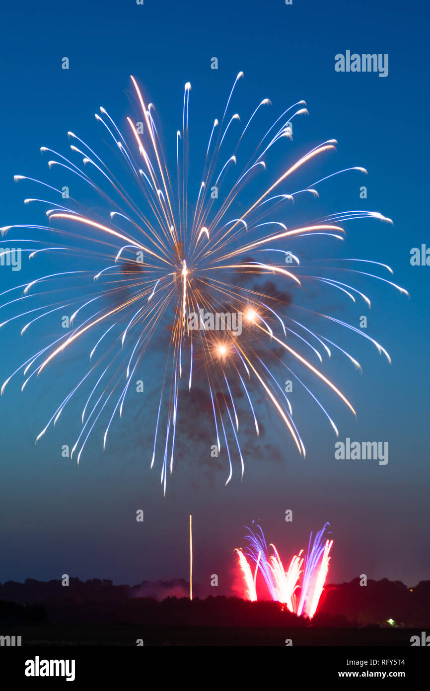 Fourth of July fireworks over small town America.  Peru, Illinois, USA Stock Photo