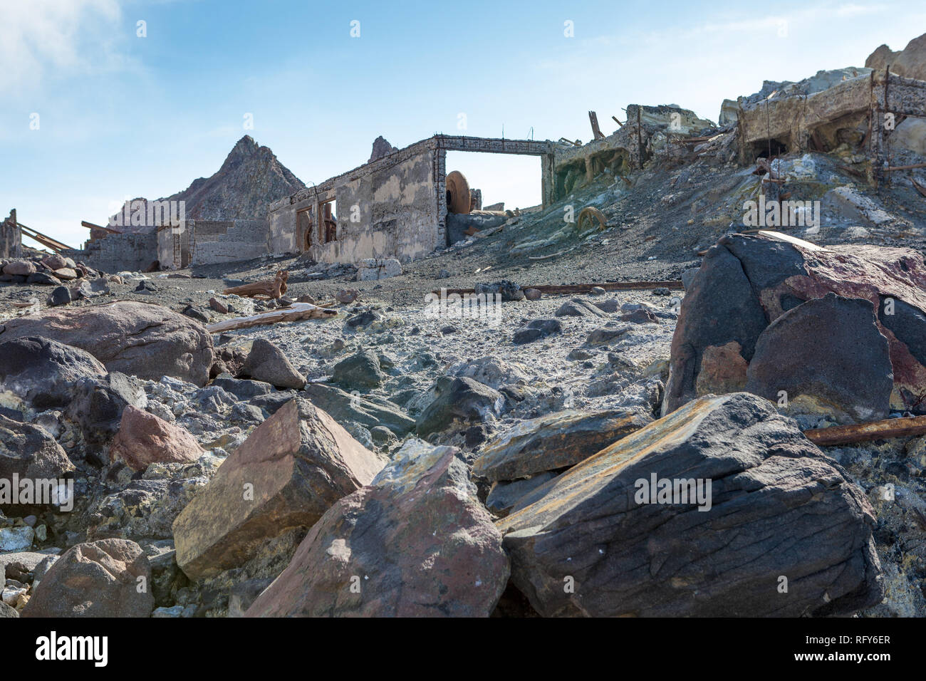 The remains of buildings after a volcanic eruption resembles a war zone. - Stock Image