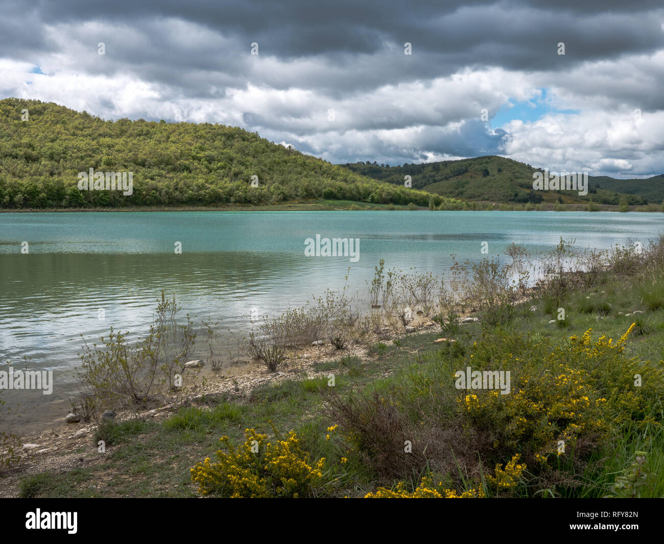 Retention basin for agricultural irrigation, Vitoria mountain range, Basque Country, Spain - Stock Image