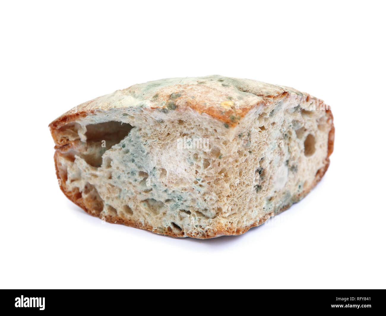 Moldy bread isolated on white - Stock Image