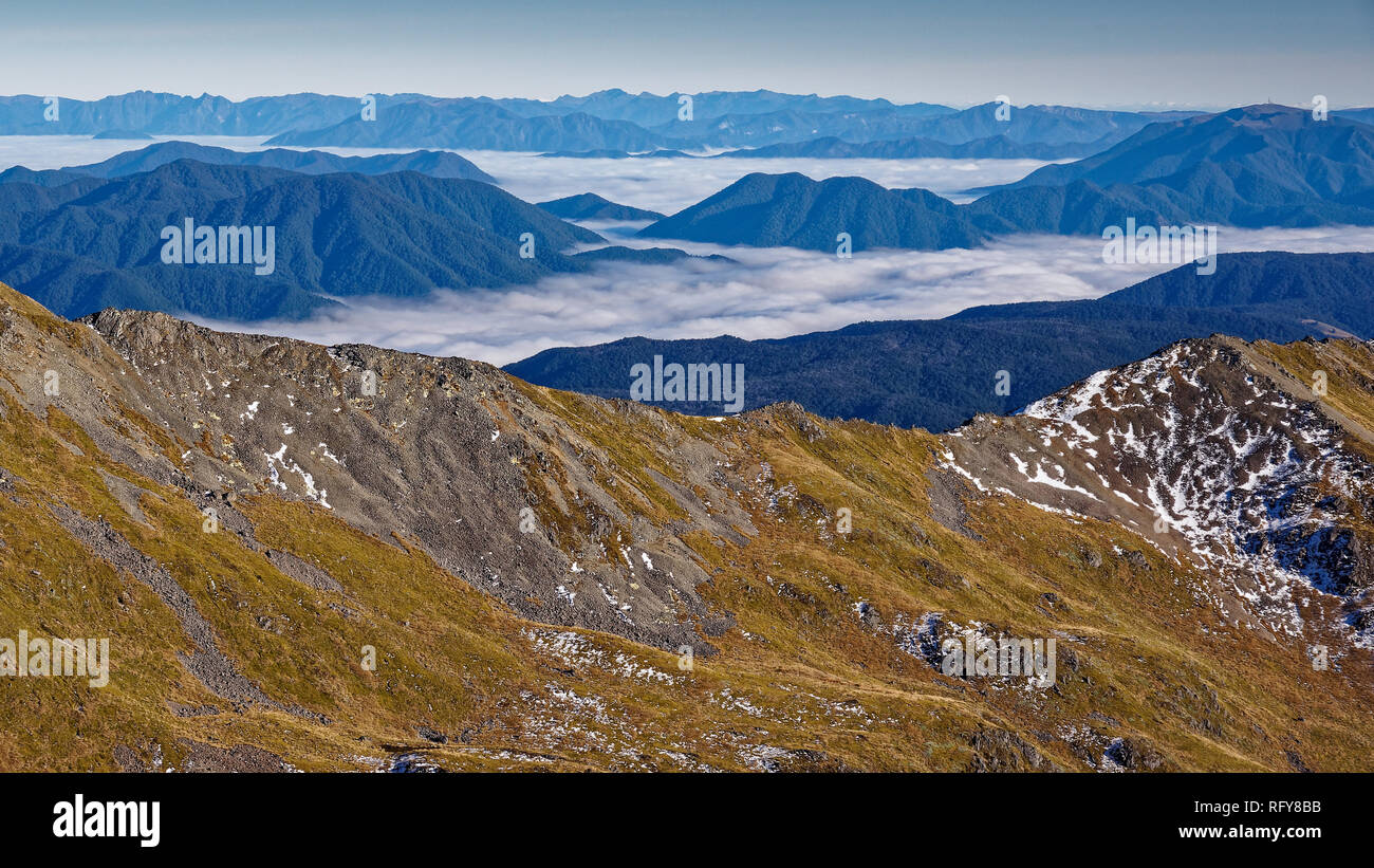Looking down on clouds, Nelson Lakes National Park, New Zealand. On route from Angelus hut to St. Arnaud. - Stock Image