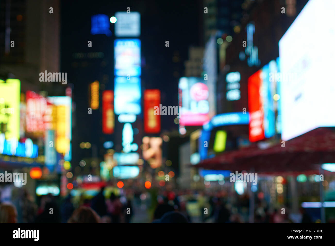 Defocused blur of New York City lights on Times Square - Stock Image