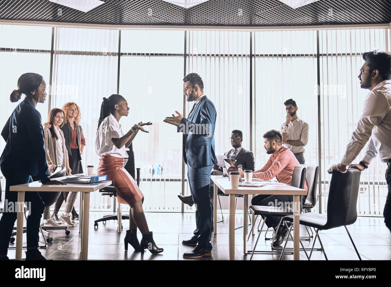 two employees are having a conflict . two views on the problem. Stock Photo