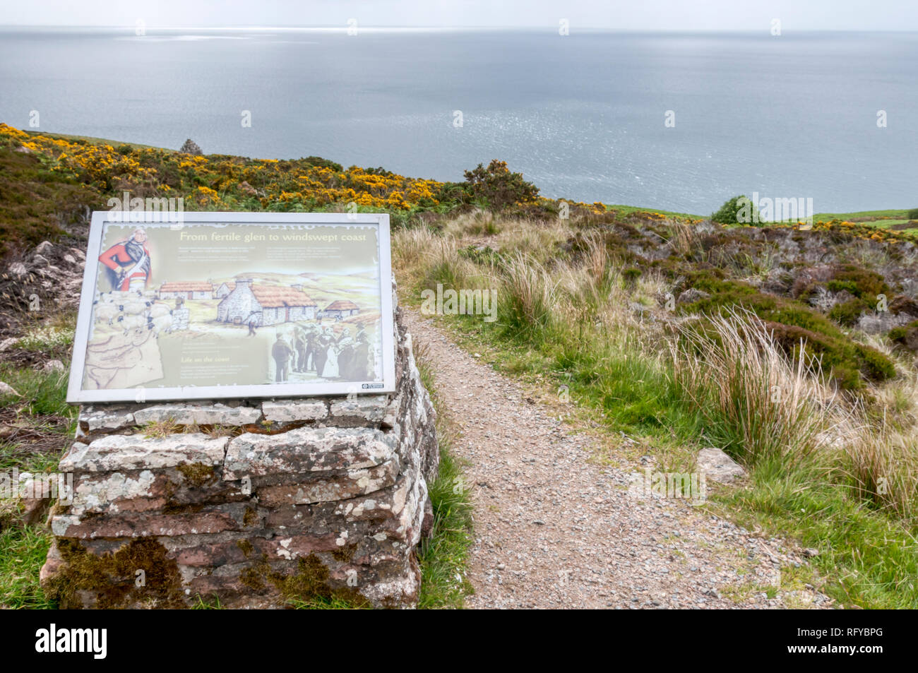 An information board on the path to Badbea, an abandoned village by the cliff tops on the east coast of Caithness, Scotland.  Details in Description. - Stock Image