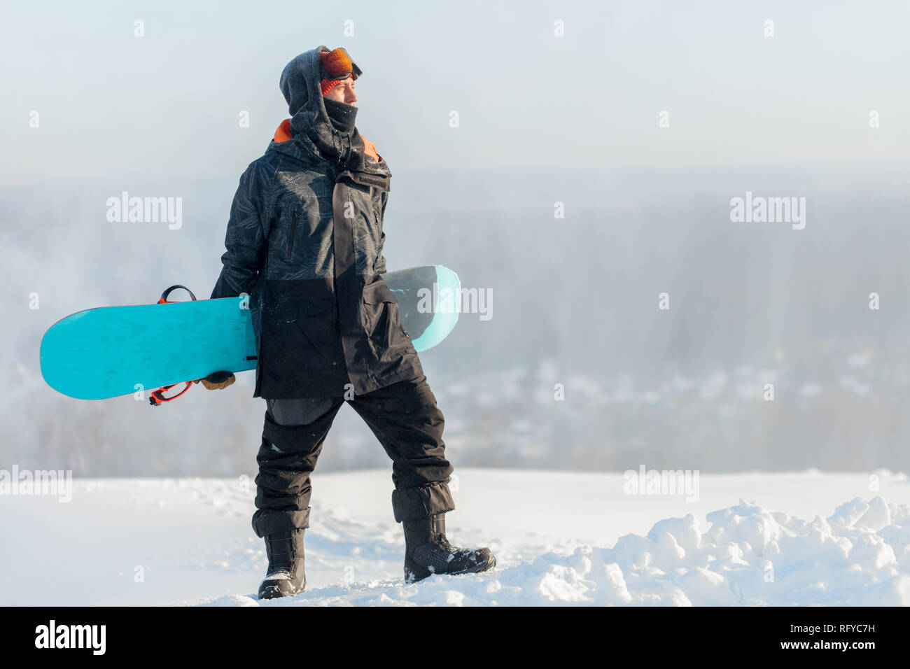 awesome snowboarder rejoicing at good day Stock Photo