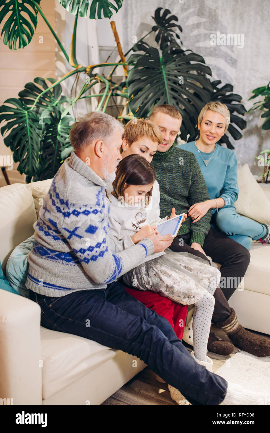 extended family looking at the screen of the computer - Stock Image
