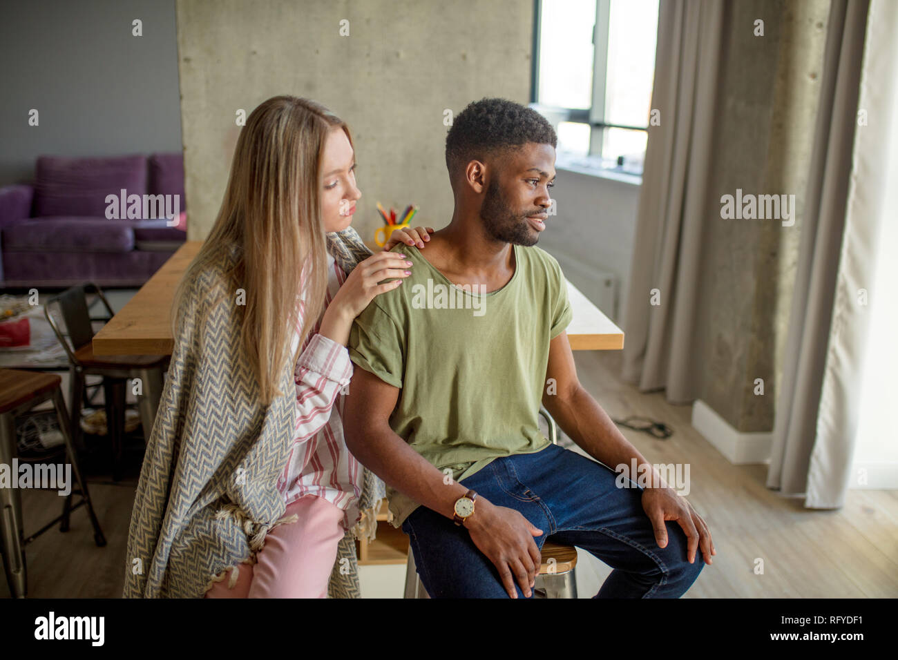 Relationship problems concept. Young mixed race couple quarelling at home. - Stock Image