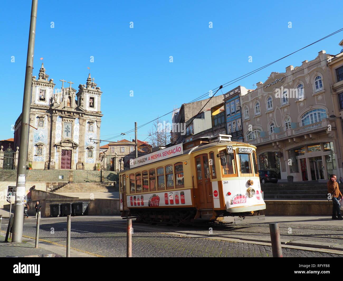 Tram running outside the church 'Igreja de Santo Ildefonso' in Porto - Portugal - Stock Image