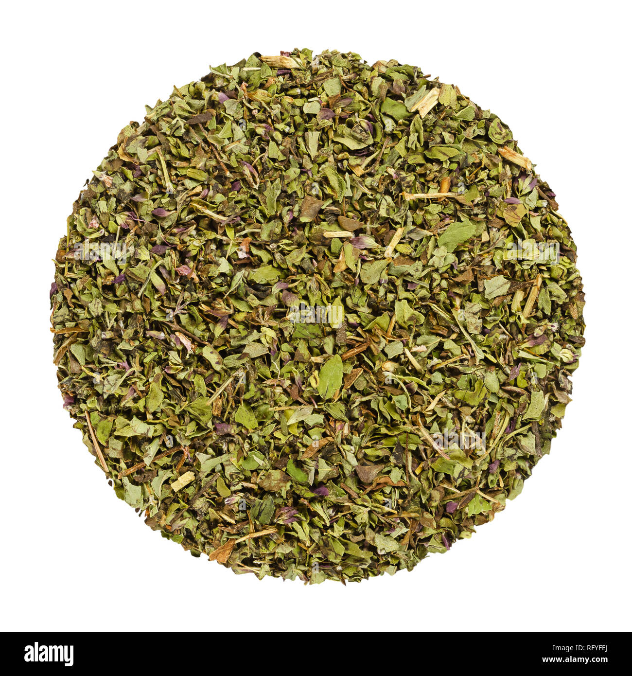 Dried oregano, herb circle from above, isolated, over white. Disc made of Origanum vulgare, sometimes wild marjoram. Herb. - Stock Image