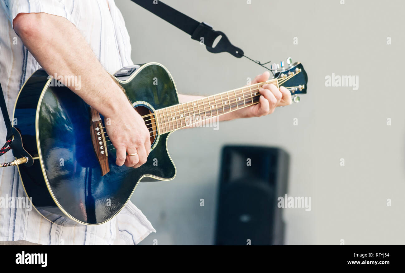 guitarist playing at city park jazz festival on sunny summer day - Stock Image