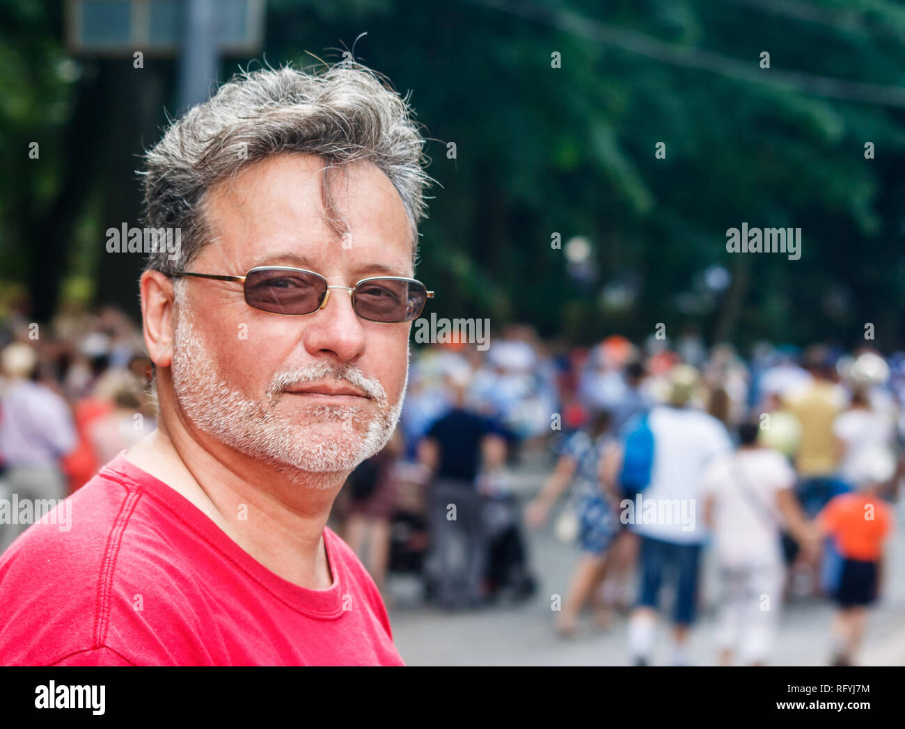 21eff13c8c6e portrait of an elderly man with glasses and gray beard in the city park on  sunny