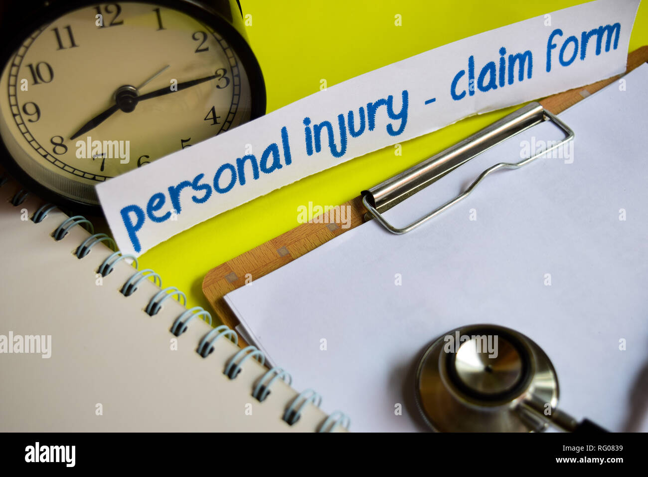 Personal injury - Claim form on healthcare concept inspiration on yellow background - Stock Image
