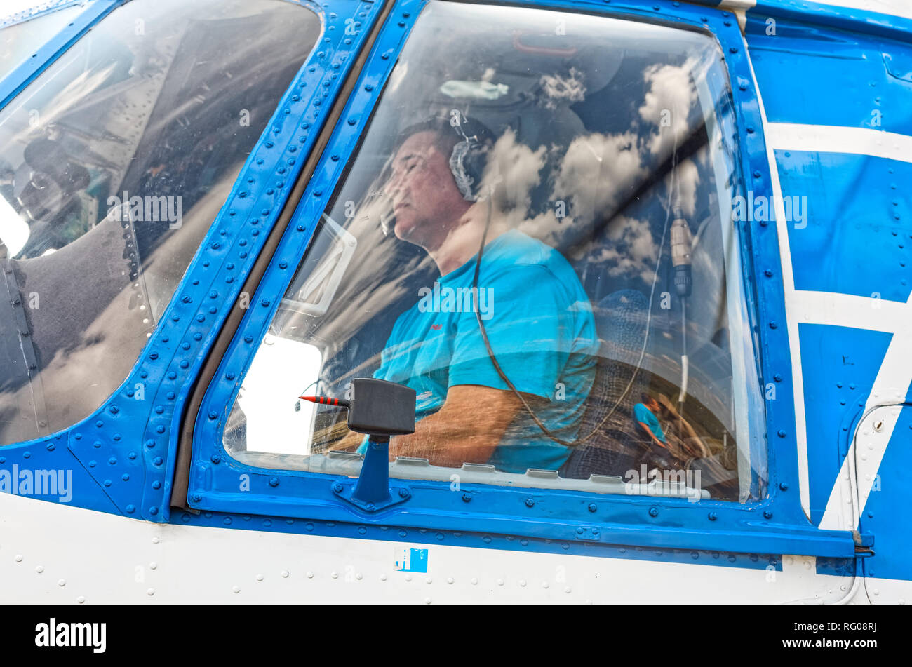 Yamal, Russia - August 2011: Portrait of a pilot of a MI-8T helicopter close-up in a cockpit window. - Stock Image