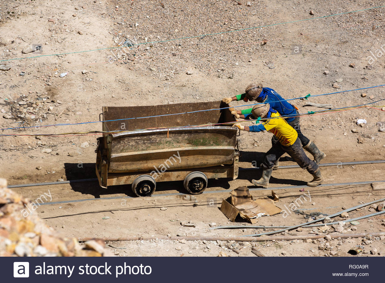 Miners at work at the mineral mines of the Cerro Rico mountain in Potosí, Bolivia - Stock Image