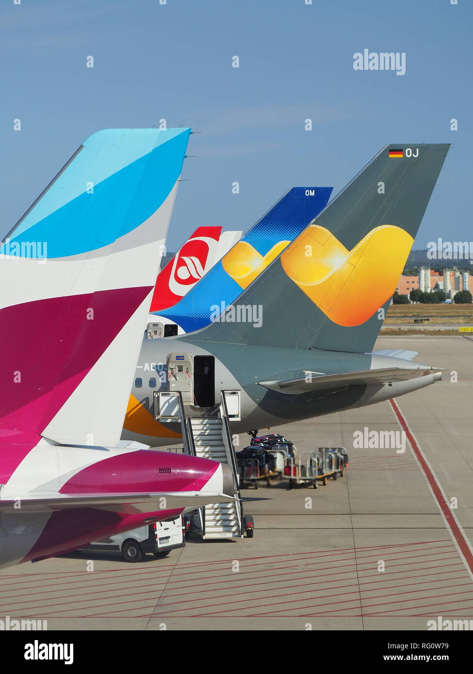 Group of vertical stabilizers of different airlines - Stock Image