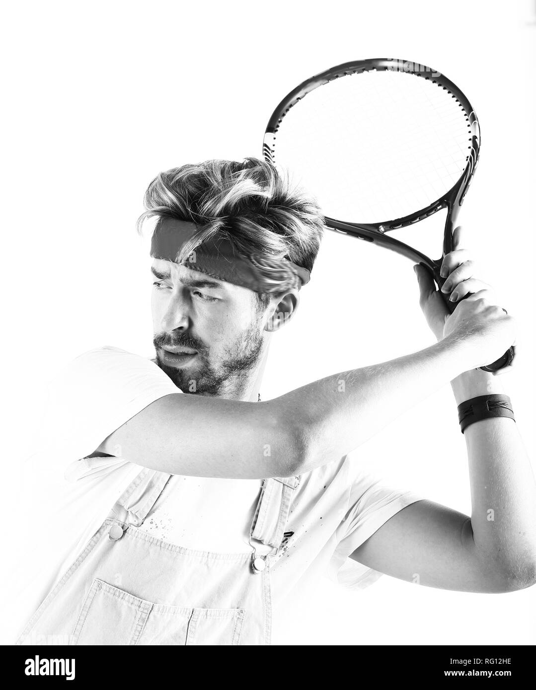 Male tennis player with racket in action. - Stock Image