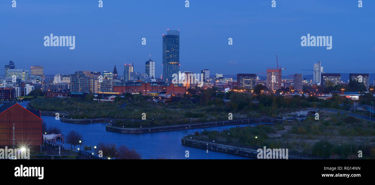 An evening panoramic of Manchester city centre UK - Stock Image