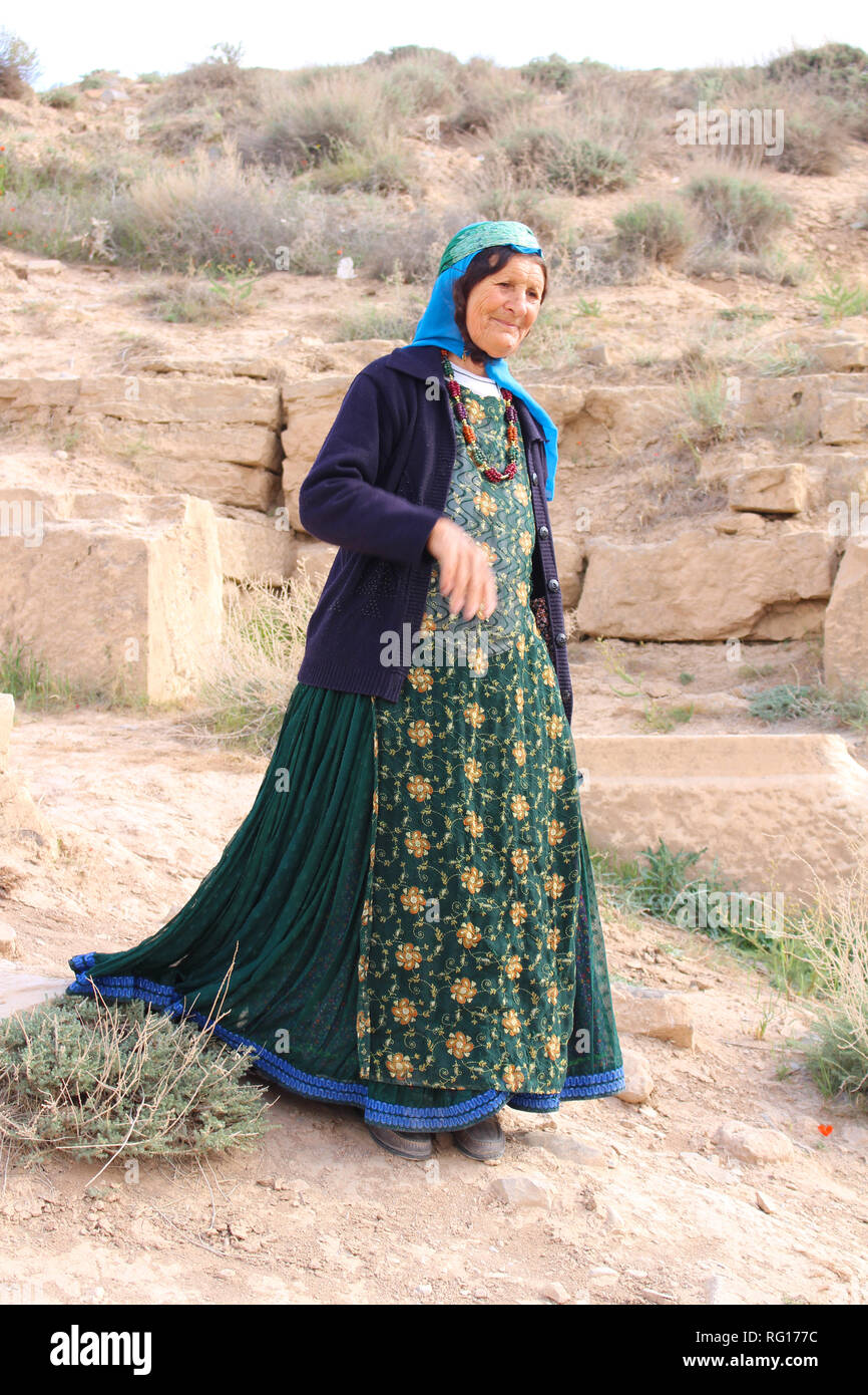 An Iranian woman with a typical costume in Pasargadae, Iran - Stock Image