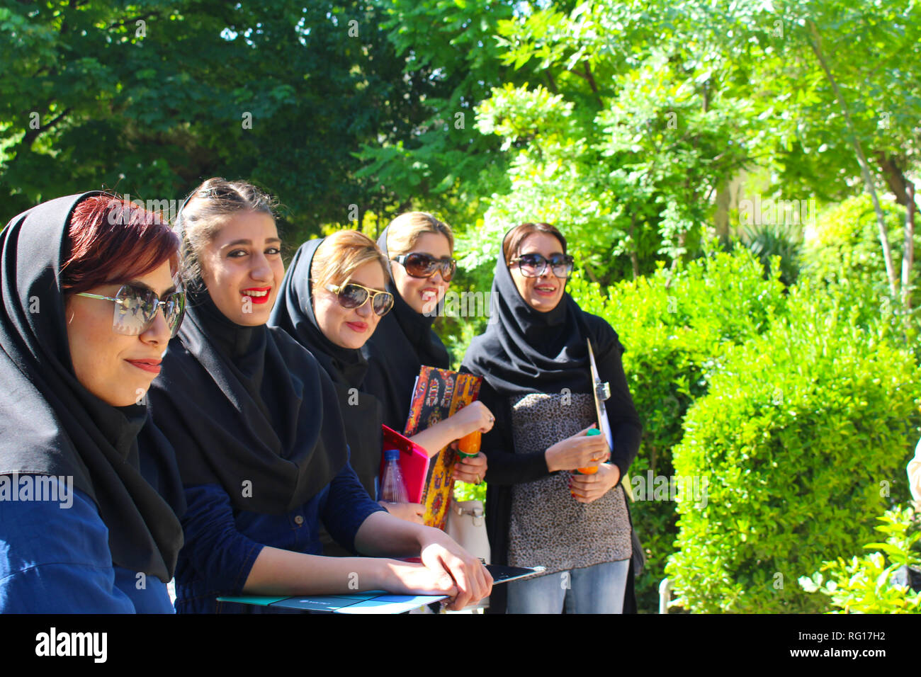 A group of young Iranian women with typical dress in a garden of Shiraz - Stock Image