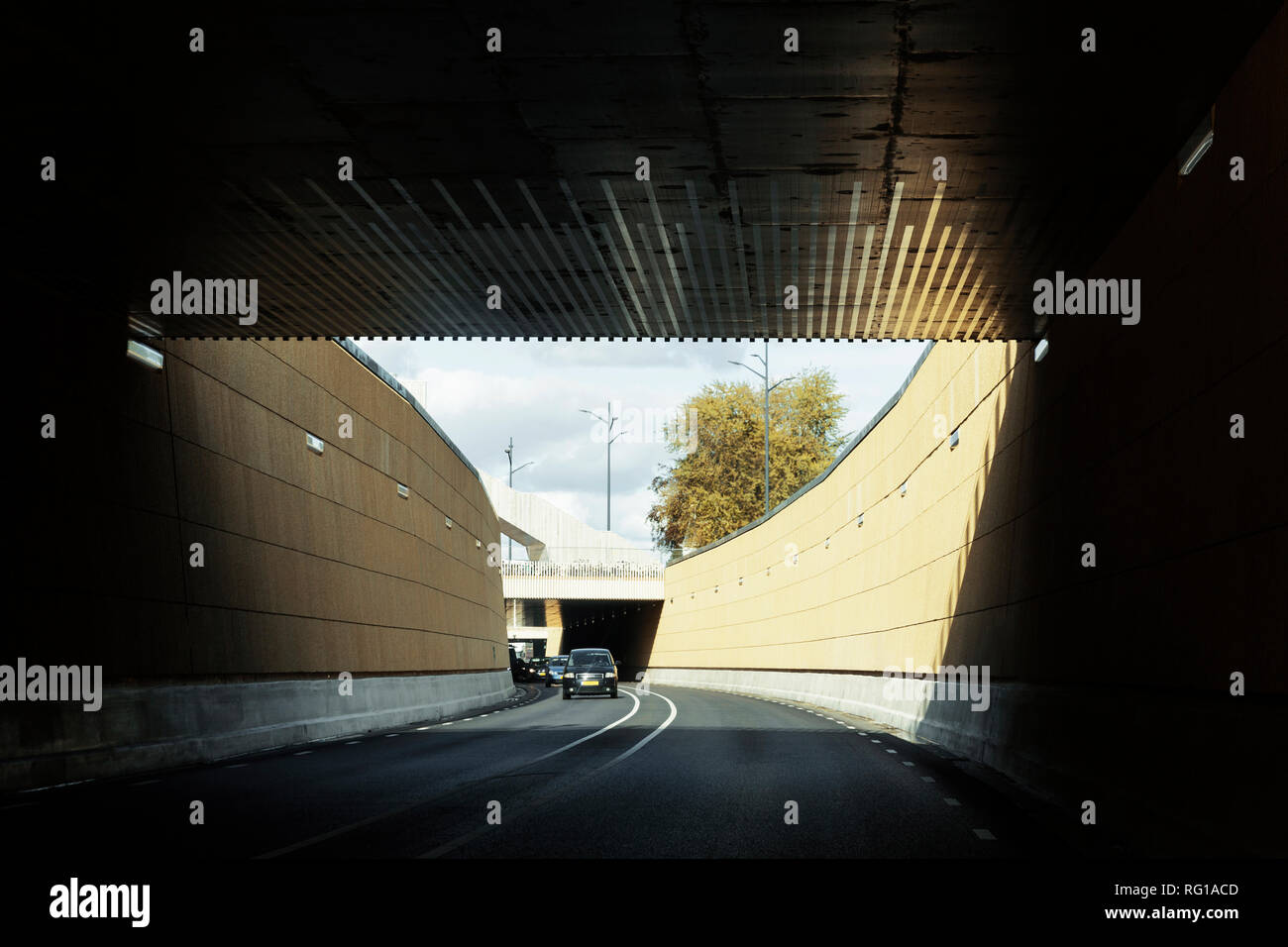 Zutphen, Gelderland / The Netherlands - September 25 2018: Modern dutch underpass cutting below train line for higher level of productivity. - Stock Image