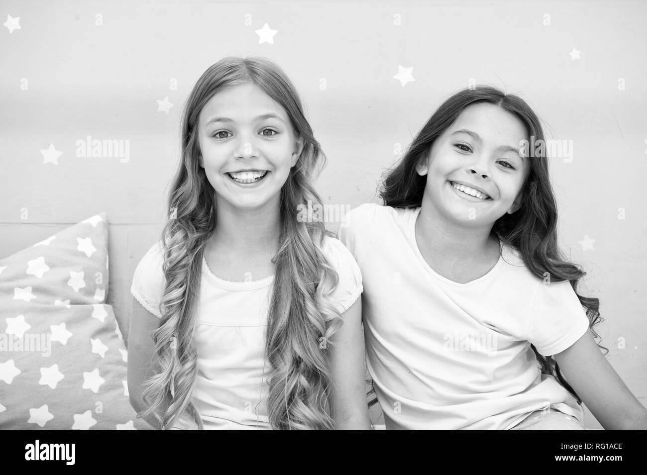 Girls children with long curly hair. Pajamas party concept. Girls just want to have fun. Girlish secrets honest and sincere. Friends kids have nice time pleasant leisure. Best friends forever. - Stock Image
