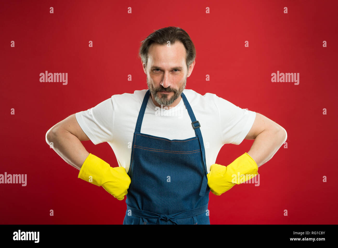 Spring cleaning. Commercial cleaning company concept. domestic helper. Maid or houseman cares about house. Bearded man.general or regular clean up. Housewife at work. - Stock Image