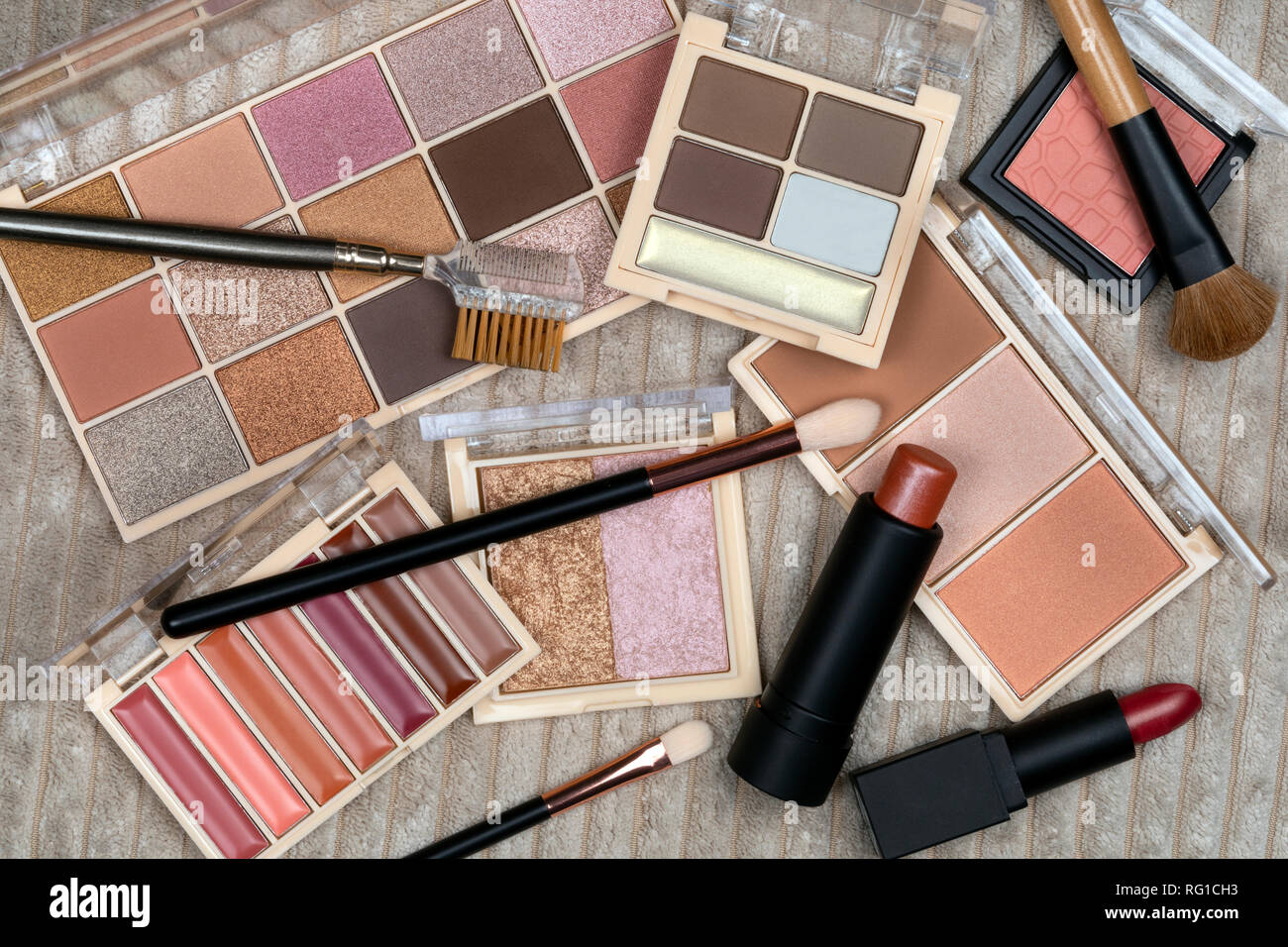 Selection of cosmetics and makeup. Cosmetics are substances or products used to enhance or alter the appearance of the face and body. Stock Photo