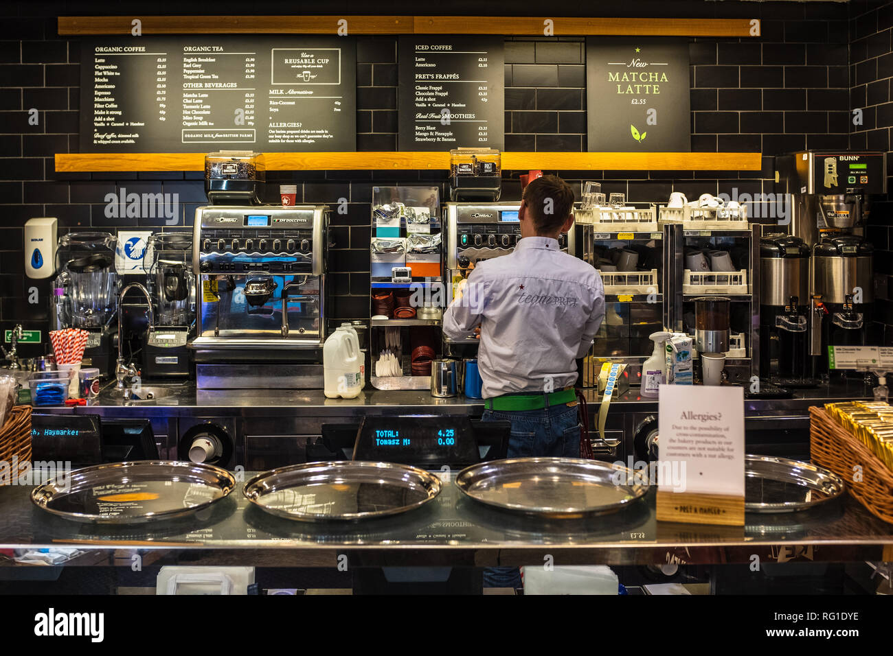 Pret a Manger service counter with Barista making coffee - Pret is a fresh food fast food restaurant chain - Stock Image