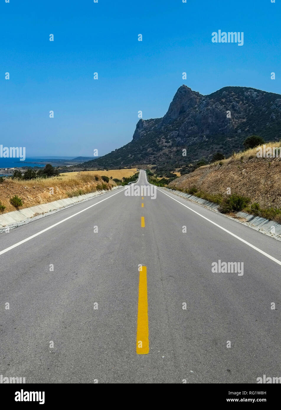 The main road looking east from Kyrenia to the Kapas peninsula, Northern Cyprus. - Stock Image