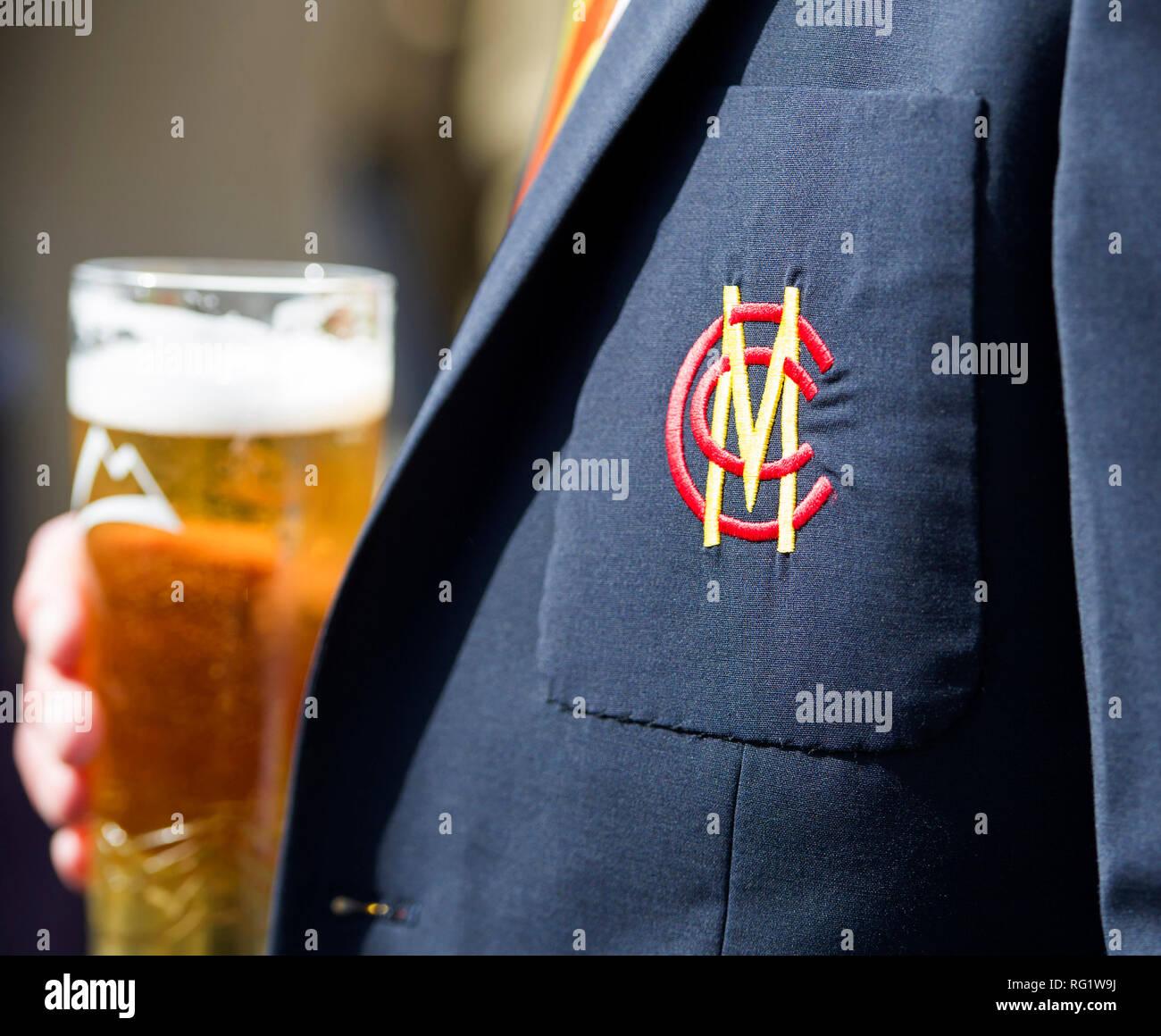 A member of the Marylebone Cricket Club enjoys a beer during the Elie Beach Cricket Festival, Elie Fife,Scotland. - Stock Image