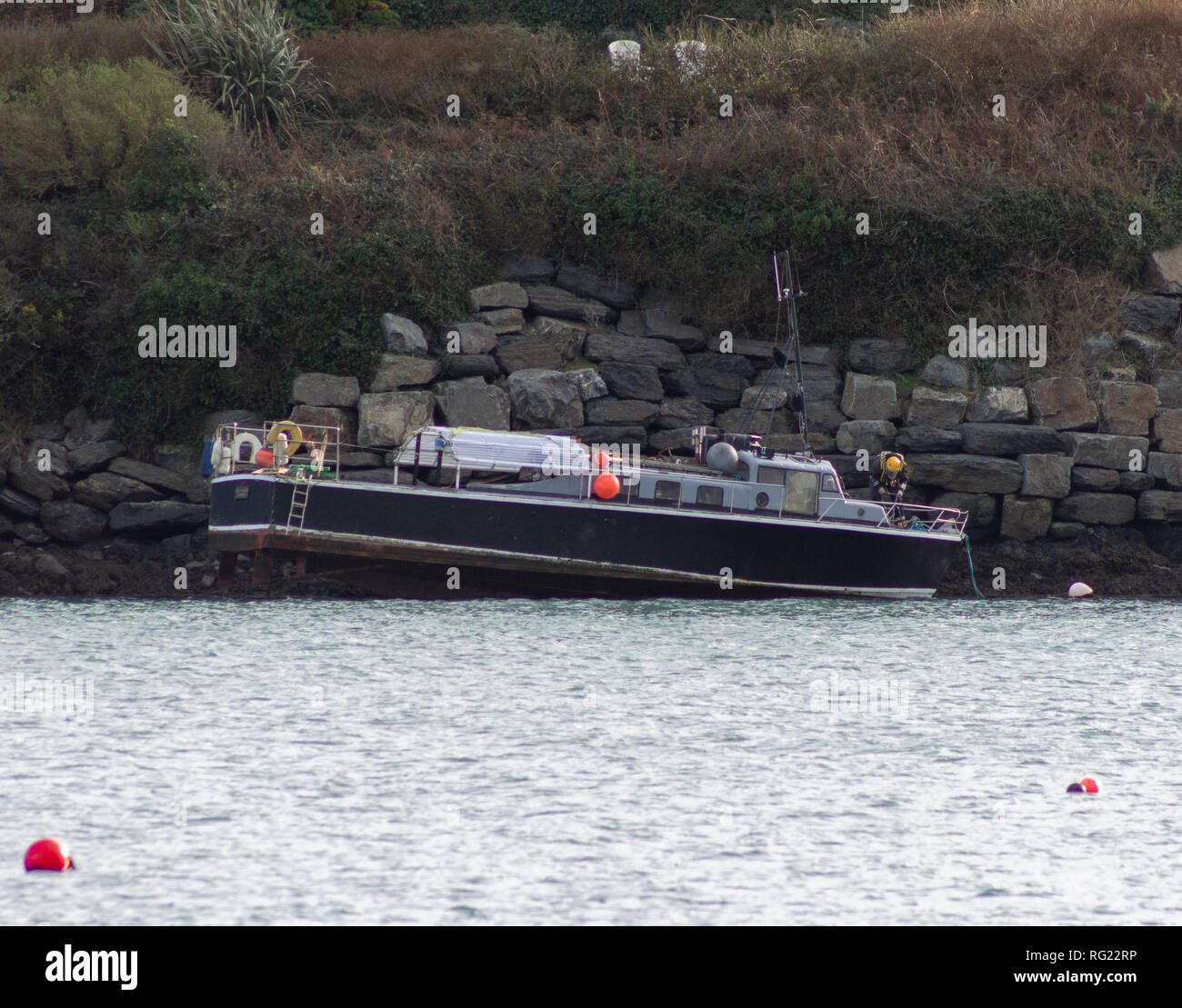 Last night's high winds found the MV Sea Tracker aground on the rocks in Castlehaven Harbour this morning. The wooden hulled vessel was stuck fast on a falling tide, the Irish Coast Guard are in attendance and no casualties are reported. Credit: aphperspective/Alamy Live News - Stock Image