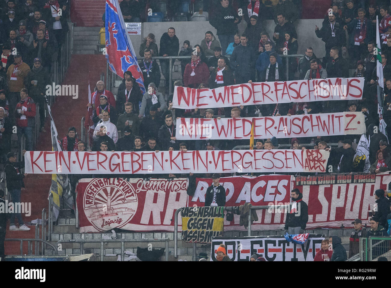 Düsseldorf, Germany. 27th January 2019.Soccer: Bundesliga, Fortuna Düsseldorf - RB Leipzig, 19th matchday. Leipzig's fans are holding up banners against racism. Photo: Marius Becker/dpa - IMPORTANT NOTE: In accordance with the requirements of the DFL Deutsche Fußball Liga or the DFB Deutscher Fußball-Bund, it is prohibited to use or have used photographs taken in the stadium and/or the match in the form of sequence images and/or video-like photo sequences. Credit: dpa picture alliance/Alamy Live News - Stock Image