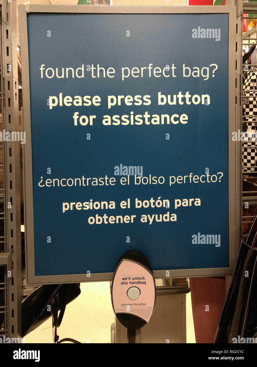Protection against theft of handbags in store. Press button for assistance. - Stock Image