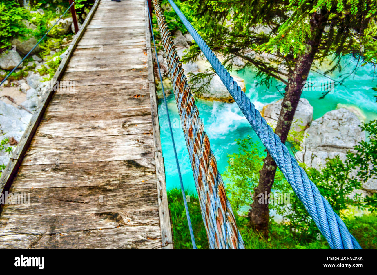 rickety bridge handrail footbridge river background wooden boards - Stock Image