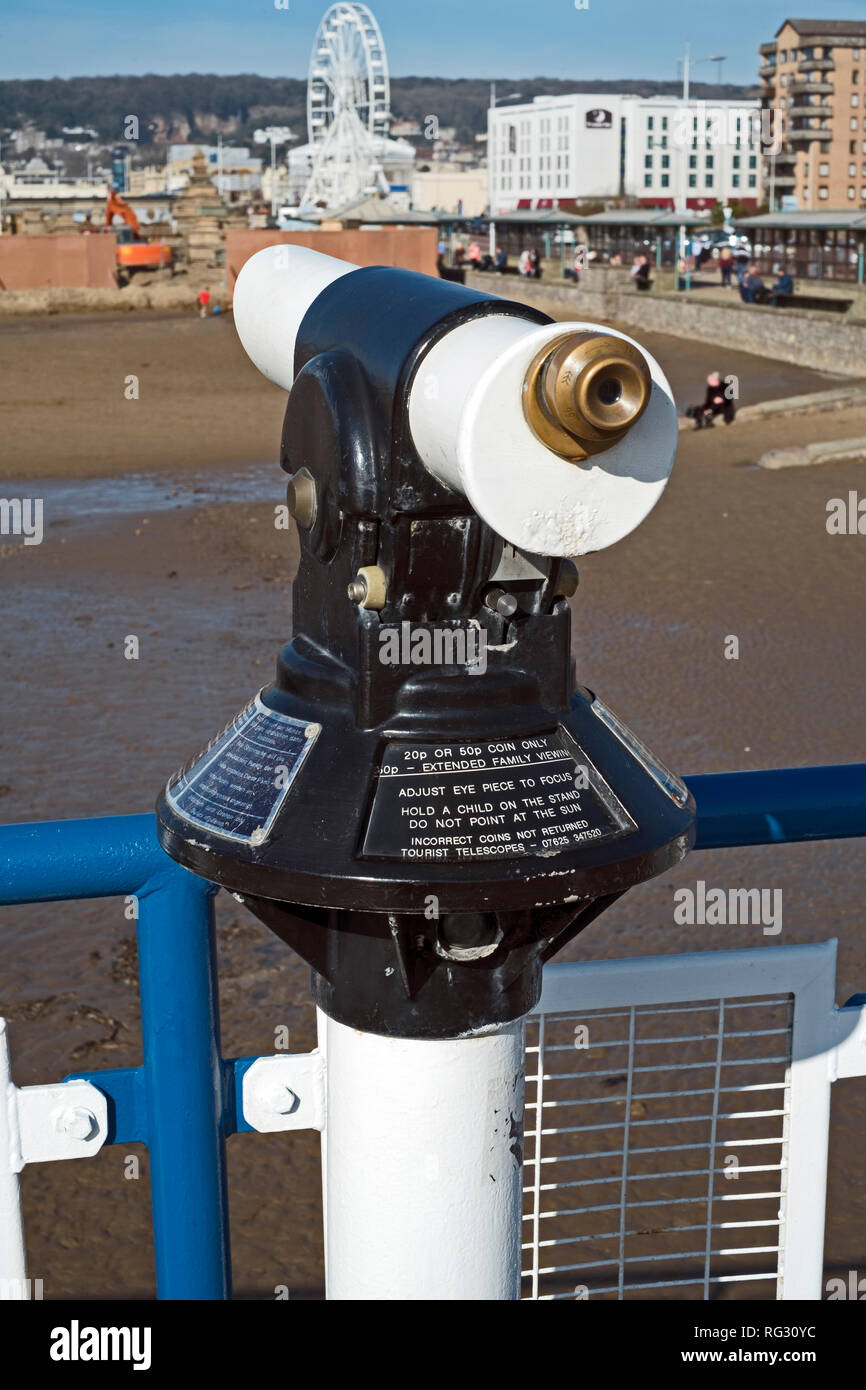 A coin-operated telescope overlooking the beach in Weston-super-Mare, UK. - Stock Image