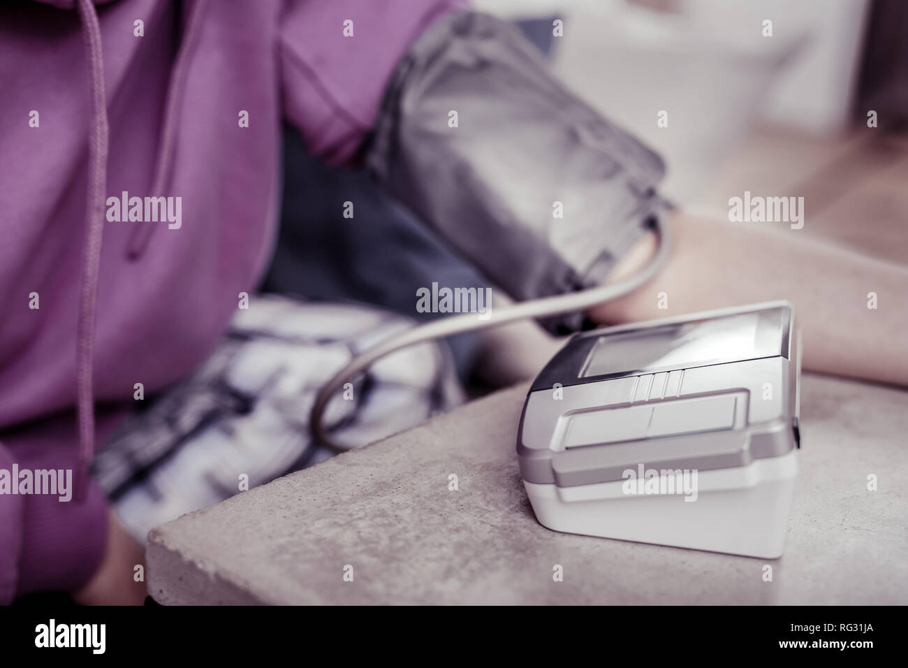 Focused photo on apparatus that standing on table - Stock Image