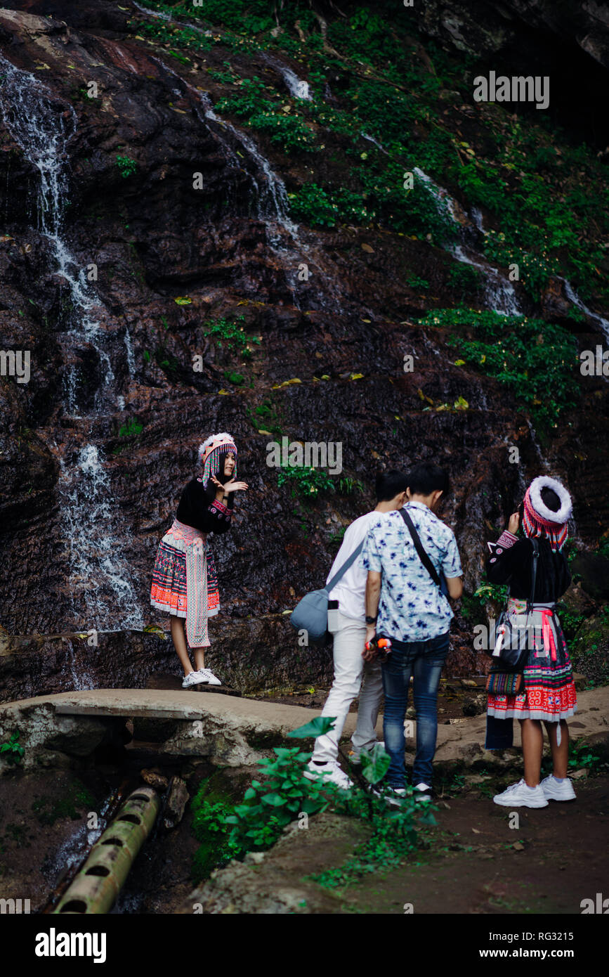 Doi Pui Tribal Village, Chiang Mai, Thailand, 12.16.18: Asian tourist dress up in traditional clothing of the Hmong tribe - Stock Image