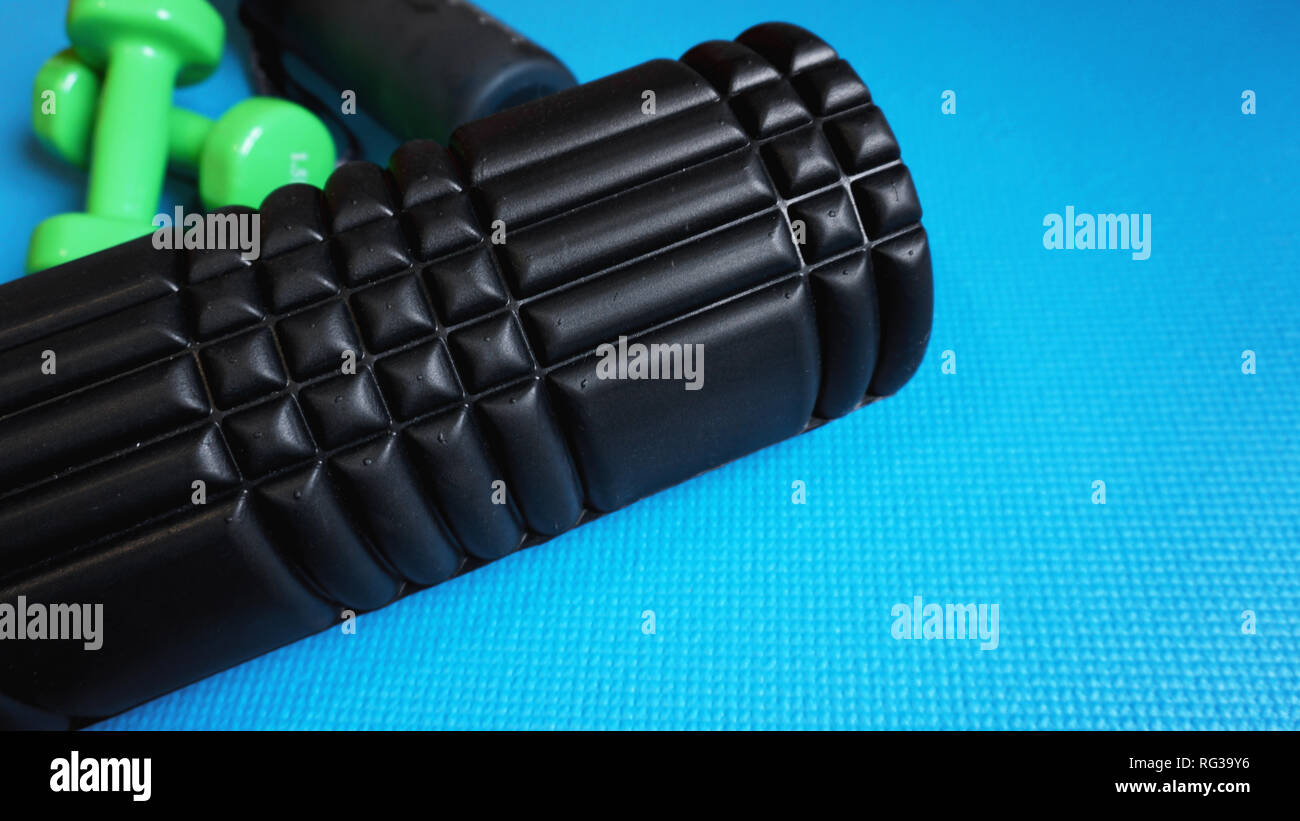 Foam Roller Gym Fitness Equipment Blue background self Myofascial Release Stock Photo