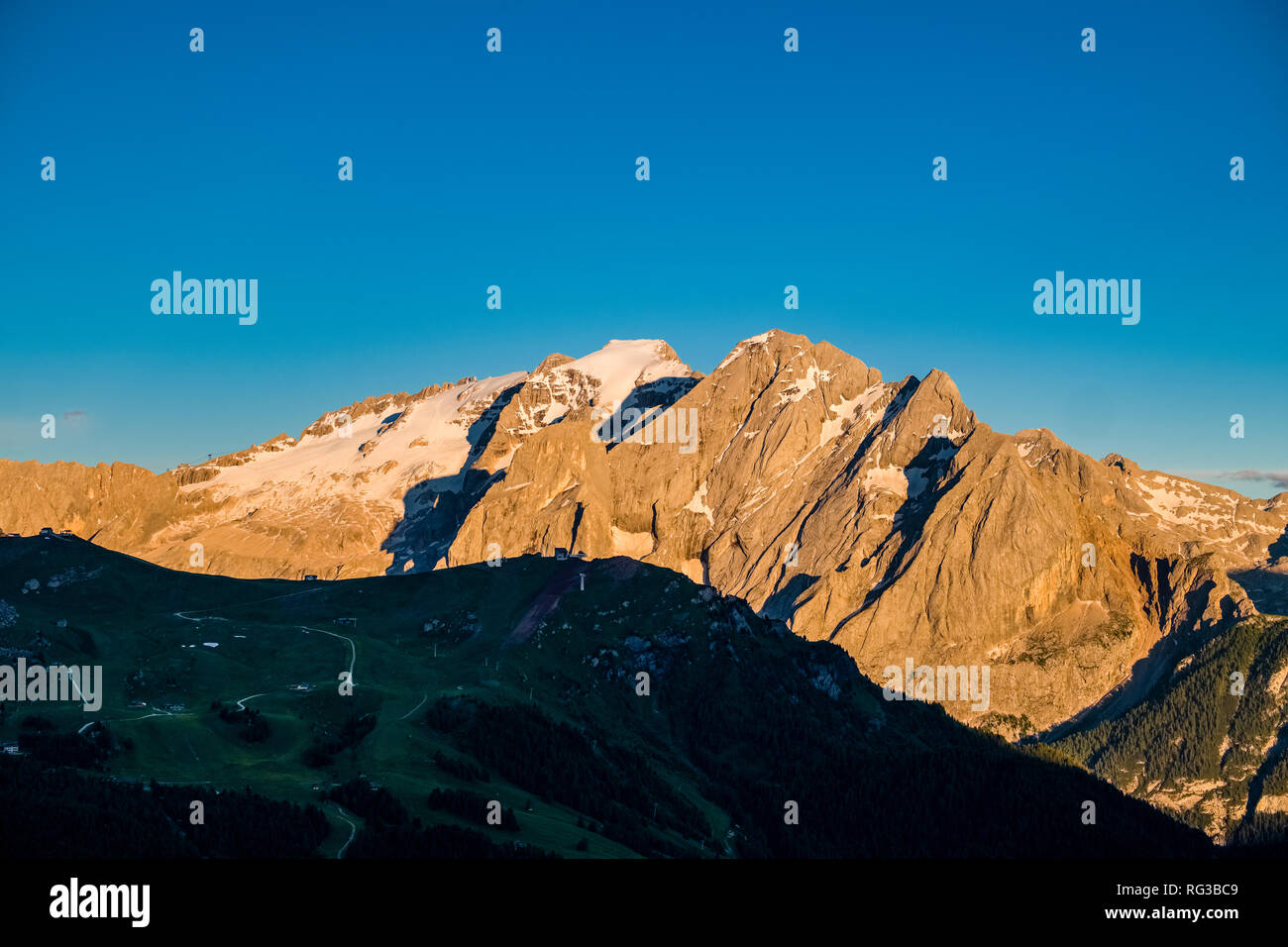View on the pass Pordoi Pass, Passo Pordoi and the mountain Marmolada from Sella Pass, Sellajoch, Passo Sella at sunset - Stock Image