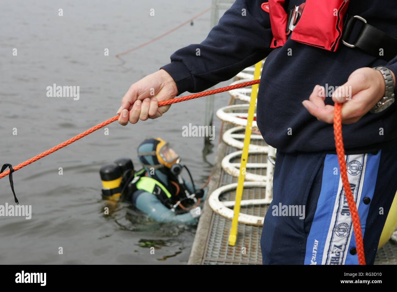 DEU, Federal Republic of Germany, Essen : Rescue diver of a fire brigade at a training. - Stock Image